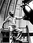 Farrell with Telescope-Holcomb Observatory